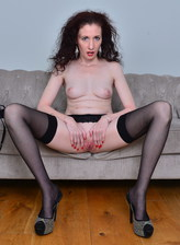Dolled-up mature Scarlet aka Stacey Robinson bends down in FF stockings & heels