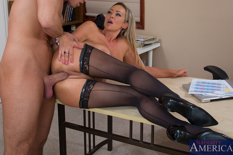 Fine blondie in black lacy lingerie and stockings having sex