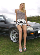 Slim Brit Angel Long leans on a car hood outdoors parting long legs & sliding her white thong aside