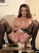 Slim milf Silvia Saige spreads legs in black stockings