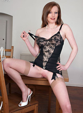 Busty hottie Holly Kiss in vintage style lacy corset and barely there nylons