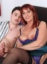 Red-haired UK mature Beau Diamonds pulls out her big jugs for a stockinged fuck