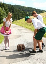 Pigtailed blonde country girl Nikky Dream launches into Tirol outdoor orgy in her white stockings