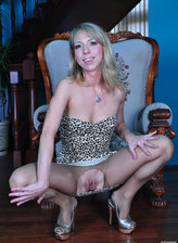 Dazzling blonde strips off and fingers in her pantyhose