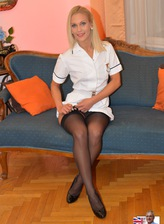 Sexy blonde nurse Cecilia Scott in white uniform and black seamed stockings spreading legs