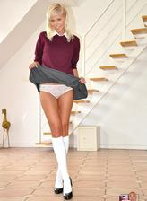 Dressed like a coed blondie teases and flashes in her white socks