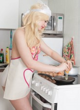 Super-sexy UK blonde Georgia Brown cooks topless in her white full-back panties