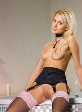 Blonde beauty Emilia slowly peels a long pink robe & lace top gartered stockings