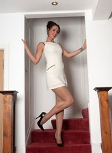 British brunette rips her sheer pantyhose to shreds on the stairs