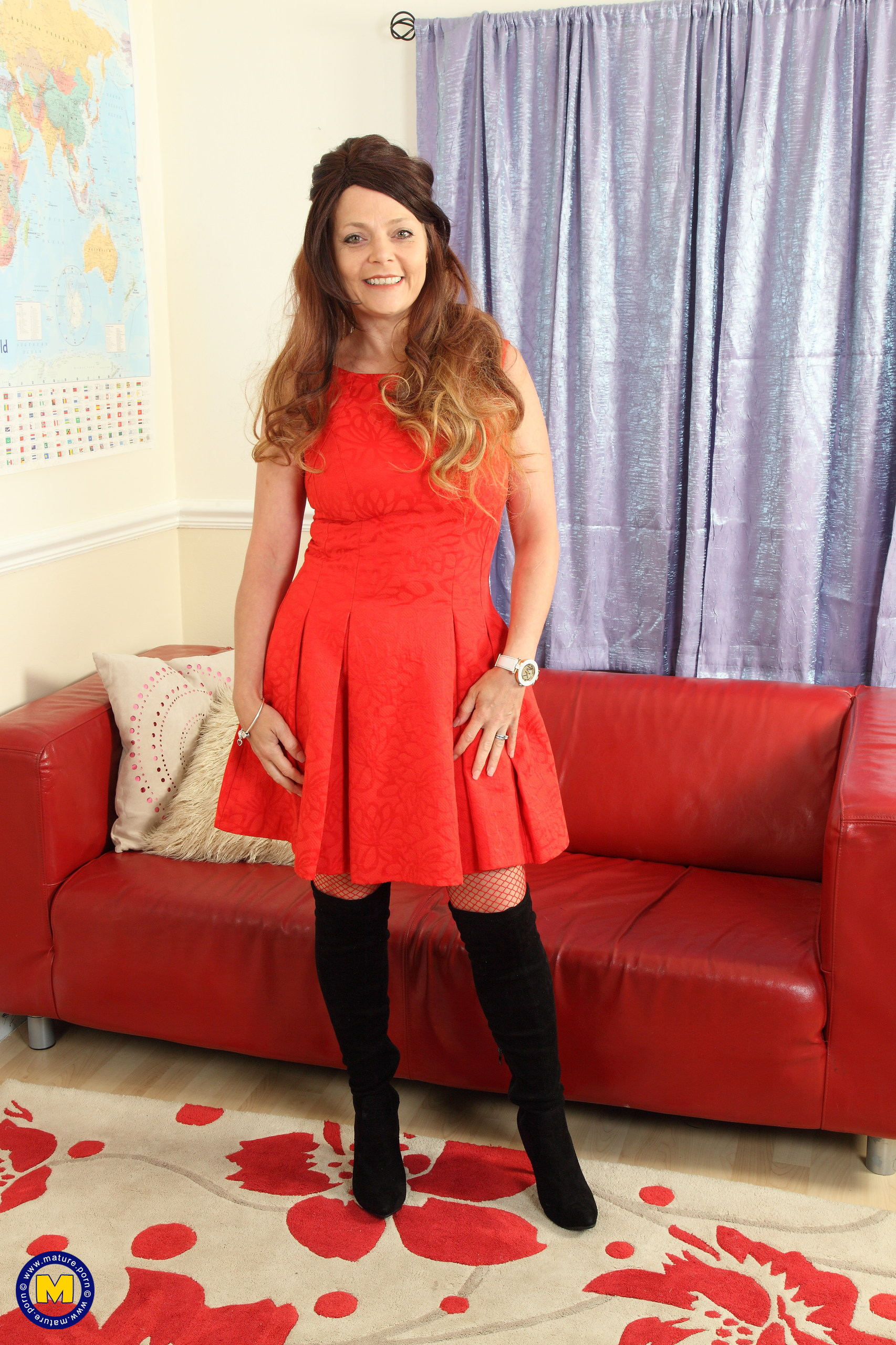 Beautiful British MILF Gemma Gold spreading legs