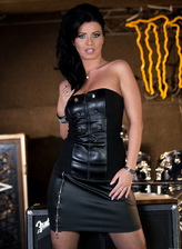Hot drummer Vicky Love wears her leather corset with fishnet suspender stockings
