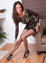 Slim-legged milf Sofie Marie shows her buns and pussy thru sheer-to-waist hose