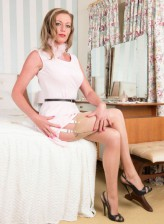 British MILF Holly Kiss in vintage lingerie, stockings and heels
