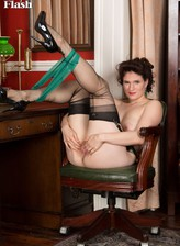 Hot Brit Brianna Green gets naughty in her vintage back seam stockings with a garter