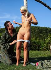 Blonde teen Lovita Fate wins a battle for a fuck in the sun out of her paintball cammies and panties
