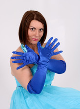 Dressed up to the nines milf Christine O. aka Raven shoves gloved hands between her stockinged legs