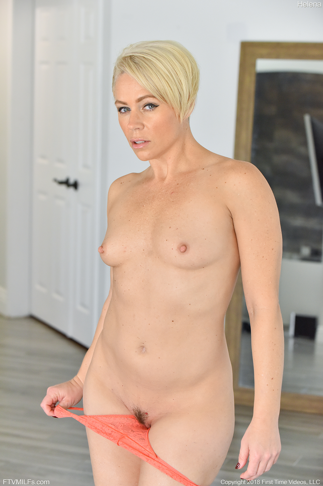 Bobbed platinum blonde Helena Locke flashes her ripe milf ...