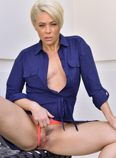 Bobbed platinum blonde Helena Locke flashes her ripe milf bod and coral thong