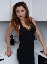 Italian mature Anetta wears all black stripping down to her sexy opaque holdups