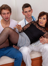 Mature slut Danny Bloom taking on two younger cocks at once