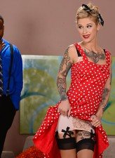Dressed in pin-up style Kleio Valentien services a black schlong wearing her two-tone FF stockings