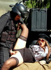 Tough busty bitch in black stockings and boots gets a SWAT cock