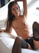 Beautiful Carin enchants with her mile-long legs in black stockings and garters