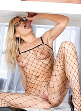 Wearing her fishnet bodystocking and glasses Amanda Tate milks her client under the massage table