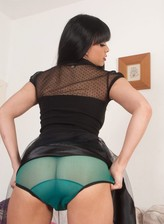 Busty British chick Sasha Cane flashes her retro style green see-thru panties on cam
