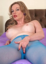 Teasing lady Holly Kiss strips down to her smashing blue sheer-to-waist pantyhose