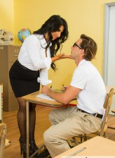 Hot black-stockinged chemistry teacher Raven Hart tit fucks and rides a shy young man after classes