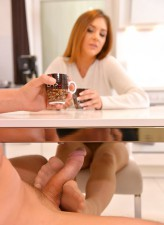 Redheaded German hottie Lullu Gun gives a teasing footjob before thru-pantyhose sex in the kitchen