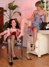 Two lezzies change into luxury corsets and stockings for wet play