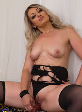 Trendy milf Miya reveals her sexy black teddy and holdups before using a dildo