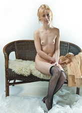 Red-haired cutie Jenara A parts fishnet clad legs to take a finger in both of her holes