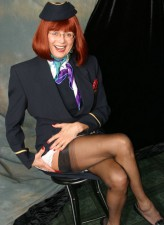 Mature stewardess flashes red lingerie with classy black nylons
