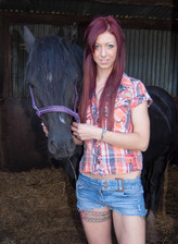 Tattooed redhead Leanne Luv dildo toys by the horse stable in panties and boots