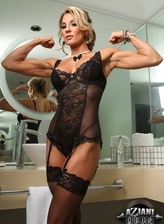 Sexy fitness babe Abby Marie models her see-thru lacy teddy and fishnets at the bathroom mirror