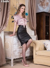 UK hot thing Stella Cox rides up her pencil skirt to show the tops of vintage fully-fashioned nylons