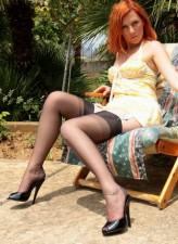 Red-haired milf showcases her legs and feet in wet seamed RHT stockings in the sun