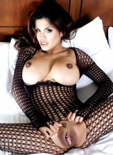 Super busty bombshell Alexis Amore spreading in her net crotchless bodysuit