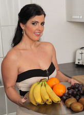 Mature housewife Montse Swinger brings a tray with fruit for her stockinged sexcapade in the kitchen