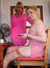 British old and young lesbians Amy and Amber West get it on wearing pink undies and tan stockings