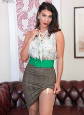 Drop-dead gorgeous Roxy Mendez wears retro lingerie, garters and nylons under her smart pencil-skirt