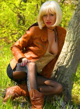 Blonde milf spreading legs in patterned pantyhose in the woods