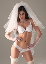Sexy babe Little Caprice strips her wedding gown to show white bridal stockings