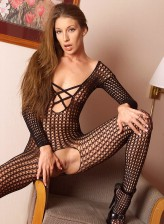 Naughty Brandi Lyons exposing and playing with herself in fishnet body suit