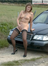 Bold gal rubs her pussy outdoors wearing just nylons and heels