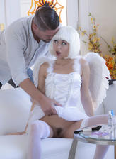 Riley Reid dons her angel wings with a white corset set and stockings for a bang