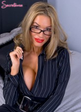 Seriously busty British secretary Tiffany James wears blue top stockings and plays with her pussy